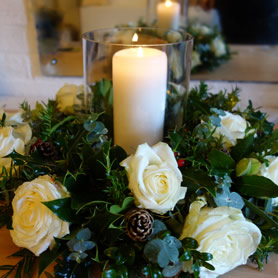 Christmas flower arrangement of white roses.
