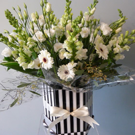 Large hat box of classic all white seasonal flowers.