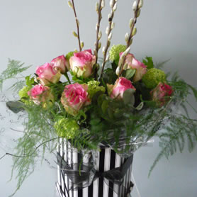 Our vintage hatbox of 12  large headed roses with foliage.