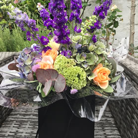 Florist's choice. Contemporary gift bouquet of best available seasonal flowers.