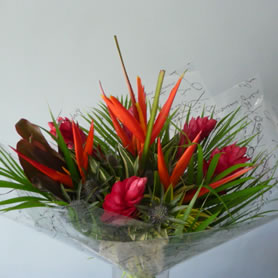 Large Tropical aqua- packed bouquet contains a mix of gingers and heliconias with tropical foliage.
