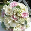 Bridal bouquet of 'Avalanche' roses and freesia