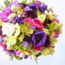 Vibrant spring wedding bouquet of anemones, ranunculus , hellebores and muscari