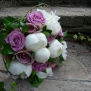 Hand tied bridal bouquet of 'Cool Water' roses, vintage 'Amnesia' roses and white peonies.