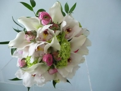 Beautiful wedding bouquet of lightly scented cream peonies, pale pink 'Sweet Spring hand tied bridal bouquet