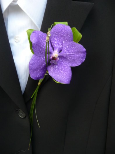 Buttonhole of a blue Vanda orchid with diamante detail.