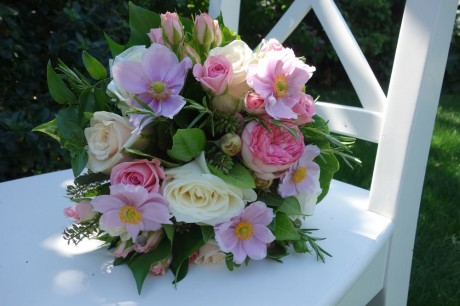 Hand tied bridal bouquet of large headed 'Avalanche' roses
