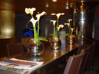 Calla lilies in mirrored vases