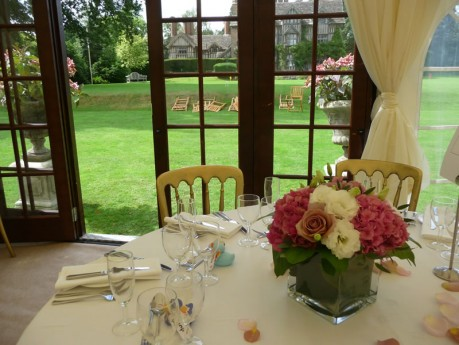 Cubed vases of pink hydrangea, white double lisianthus and vintage 'Amnesia' roses