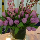 Cube vase of tulips and prunus