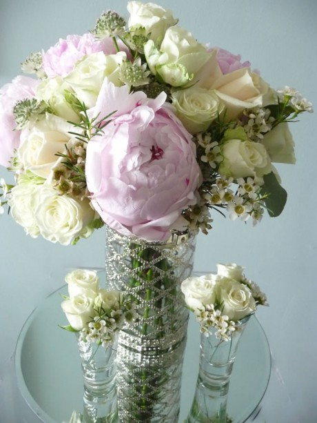 Vintage themed table flowers of peonies, roses and wax flowers