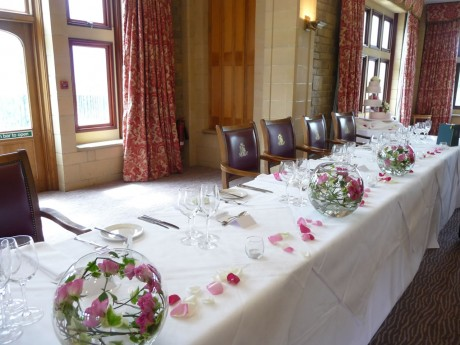 Large fish bowls of spray roses at South lodge hotel