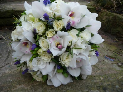 Hand tied bridal bouquet of scented spring flowers.