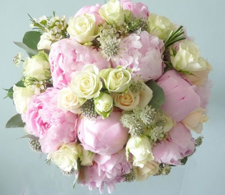 Hand tied wedding bouquet of peonies, astrantia and wax flowers.