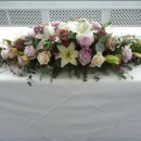 Vintage style top table arrangement of soft lilac and vintage champagne coloured roses