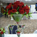 Giant martini vase of red roses.