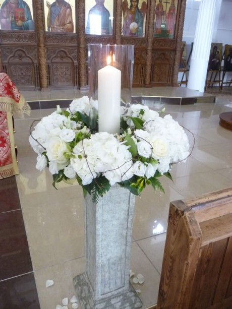 Large posy of white hydrangea on a stone plinth