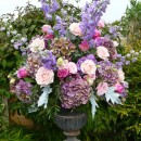 Urns filled with vintage style flowers