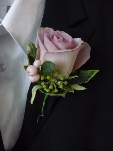 Vintage rose buttonhole.