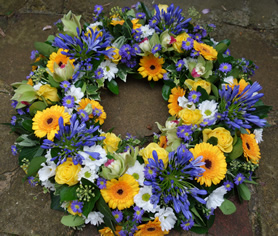 Spring wreath. Bright and bold in blue, yellow and white, this wreath is a popular choice.