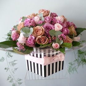 Extra large vintage hatbox of 40 roses and wax flowers with foliage.