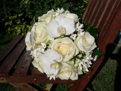 Wedding bouquet of striking white Avalanche roses