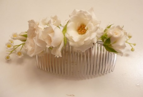 Hair comb of garden spray roses and lily of the valley