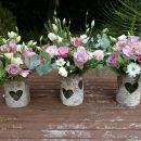 Simple rustic vases of seasonal flowers