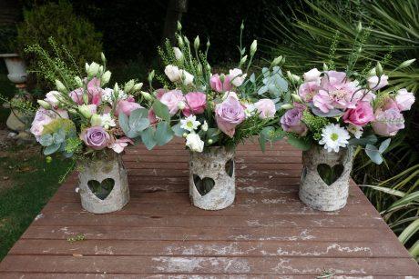 Simple rustic vases of seasonal flowers