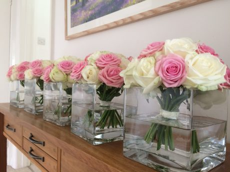Contemporary vases of roses