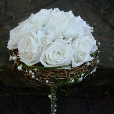 Bridal bouquet of roses with willow