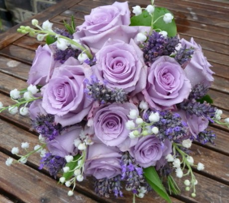 Wedding bouquet of lilac 'Ocean Song' roses teamed with scented lily of the valley and lavender.