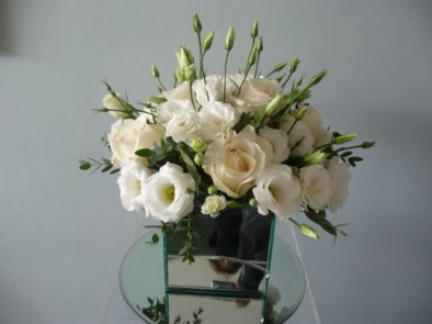 Mirrored cube vase of white eustoma
