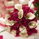 Bridal bouquet of intense cerise pink 'Milano' roses with white calla lilies.