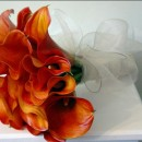 Mango calla lily bouquet, stems wrapped in white organza