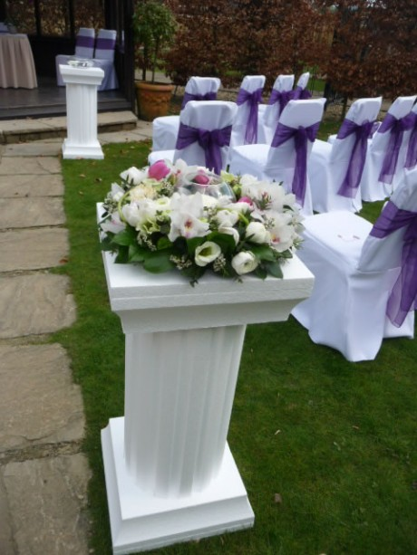 3 foot tall white plinths flank the wedding ceremony aisle at Deans Place.