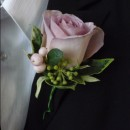Vintage rose buttonhole.