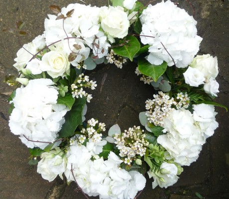 Large white funeral wreath